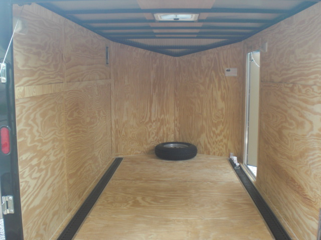 PHOTO 34: 7X12 MOTORCYCLE PACKAGE WITH HELMET CABINETS, E-TRACK ON FLOOR, PAINTED FLOORS, STAINED WALLS, & STORAGE CABINETS