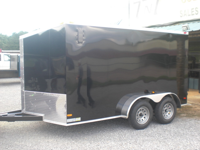 PHOTO 33: 7X12 MOTORCYCLE PACKAGE WITH HELMET CABINETS, E-TRACK ON FLOOR, PAINTED FLOORS, STAINED WALLS, & STORAGE CABINETS
