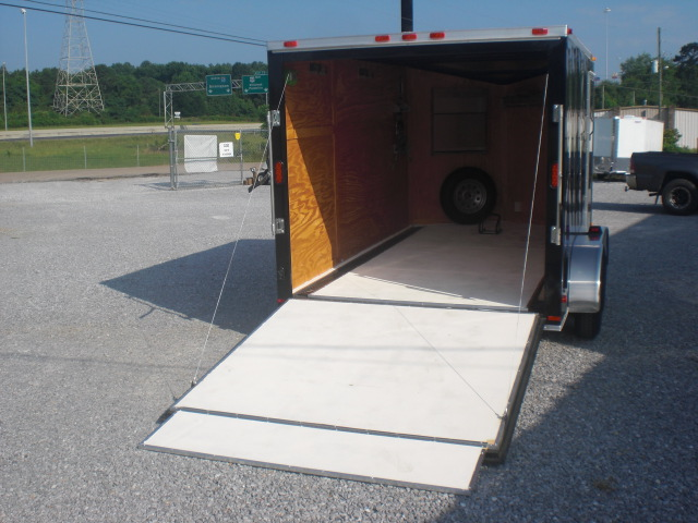 PHOTO 30: 7X12 MOTORCYCLE PACKAGE WITH HELMET CABINETS, E-TRACK ON FLOOR, PAINTED FLOORS, STAINED WALLS, & STORAGE CABINETS