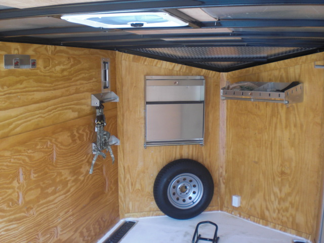 PHOTO 31: 7X12 MOTORCYCLE PACKAGE WITH HELMET CABINETS, E-TRACK ON FLOOR, PAINTED FLOORS, STAINED WALLS, & STORAGE CABINETS
