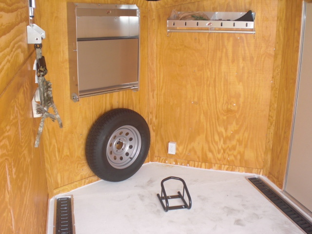 PHOTO 32: 7X12 MOTORCYCLE PACKAGE WITH HELMET CABINETS, E-TRACK ON FLOOR, PAINTED FLOORS, STAINED WALLS, & STORAGE CABINETS